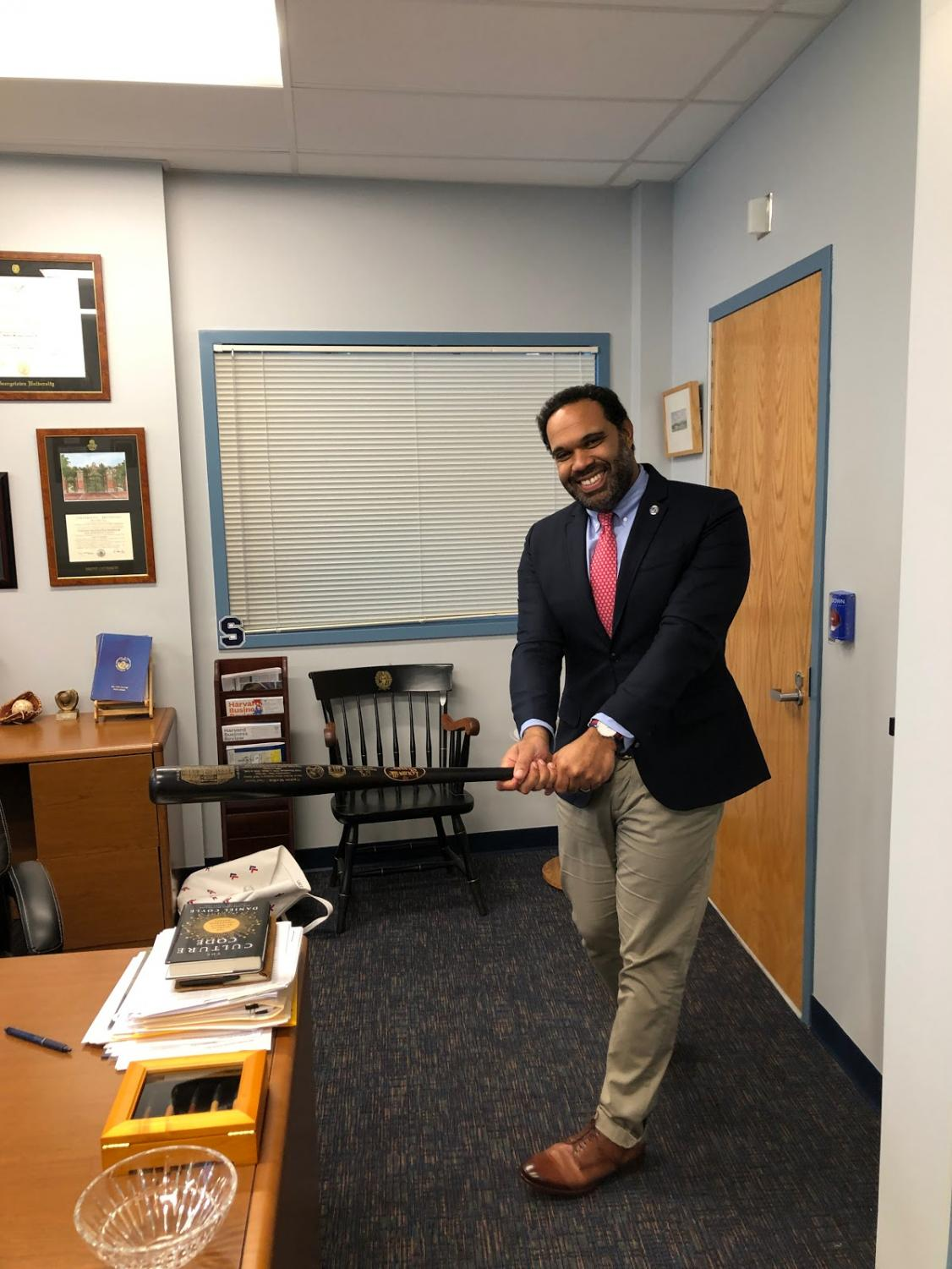 Principal Thomas channeling his old baseball skills with his signature swing. As a Yankee fan, Thomas's eyes will be glued to the television this October as he watches the Bronx Bombers try to win the World Series for the first time since 2009.