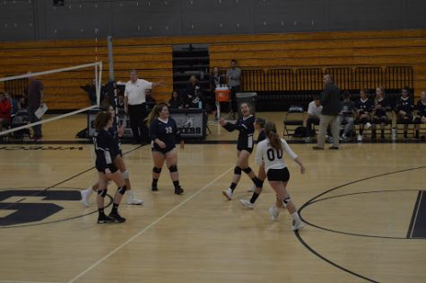 Staples celebrates a hard fought point during their game against Greenwich on Thursday, Oct. 3. Greenwich won the game, winning all three sets and extending their undefeated winning streak. The Wreckers fell to a 4-4 record.