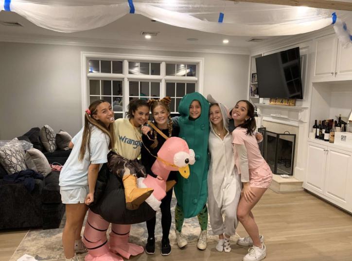 Jess+Leon+%E2%80%9922%2C+Charley+Guthartz+%E2%80%9922%2C+Viola+Geismann+%E2%80%9922%2C+Alie+Shutze+%E2%80%9922%2C+Ava+Ekholdt+%E2%80%9922+and+Gaby+Gonzalez+%E2%80%9922+dressed+in+their+playful+costumes+for+trick-or-treating+at+the+beach.+
