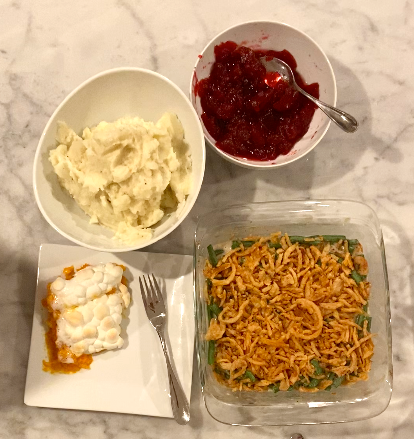 The final look of all the food made in the video. The top left is mashed potatoes, bottom left is a sweet potato and marshmallow casserole, bottom right is a green bean casserole, and finally the top right is a side of cranberry sauce.