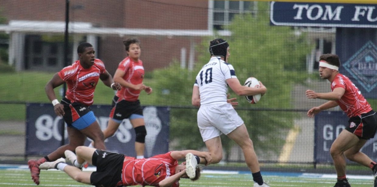 The boys' rugby team has an offensive play during a game versus Greenwich.