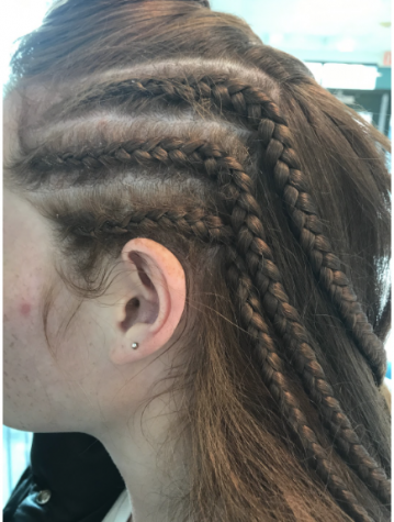 Riley Chluspa '22, a member of field hockey team, got her cornrows put in with the team and will wear them until the team loses a game or until they reach the end of the postseason.