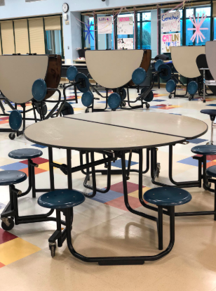 The senior section of the cafeteria sits empty during free period while many decide to stay at home during senior skip day.