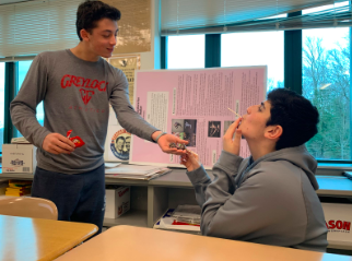 As Valentine's Day approaches, Jackson Hochhauser '22 shows his appreciation for his friend by gifting him candy.