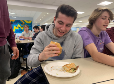 Nick Armentano '22 enjoys a sandwich from the Staples cafeteria.
