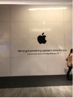 Prior to the new Apple store opening, the vast space it took up was covered by a big white wall, many customers stopped and pointed acknowledging the store.