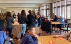 People of all ages ranging from elementary school cheerleaders, to high school athletes, to seniors all gather at the Senior Center for the annual Super Bowl Party.