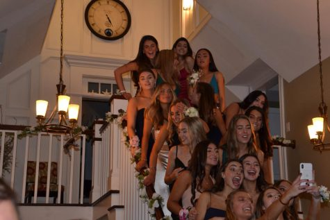 Students gathered with friends before the dance to take pictures with their friends and their dates before they arrived at the dance.