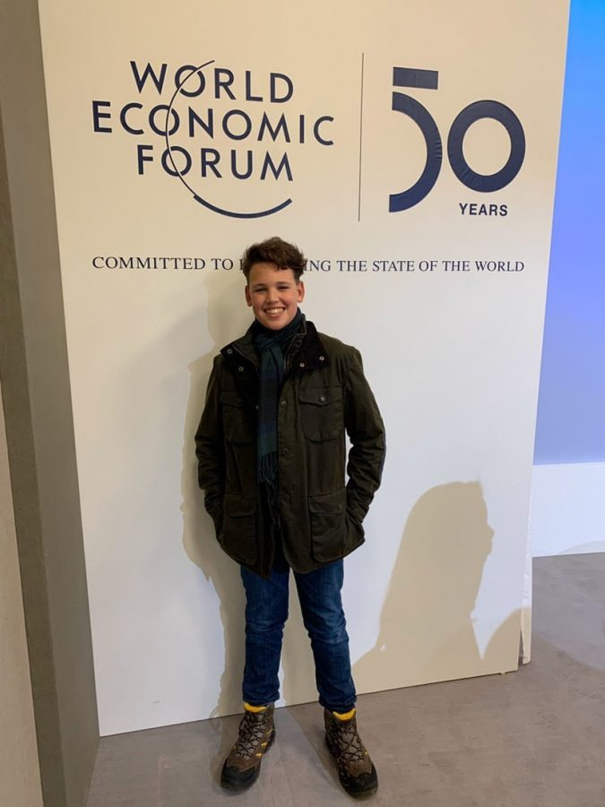 Dobin-Smith+poses+before+poster+at+a+World+Economic+Forum+open-panel+discussion+in+Davos.+The+poster+celebrates+50+years+since+WEF+was+founded.
