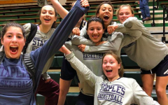 The Staples girls' basketball team celebrated their win against Norwalk High School during the FCIAC tournament. Their season has been cut short due to the cancelation of the CIAC tournament.