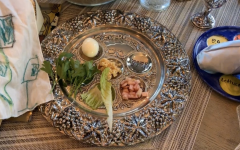 This is called a seder plate which is used on Passover. Each food is symbolic to the story of Passover. For example, parsley is a bitter herb and bitter herbs represent the bitterness of slavery.