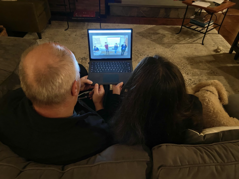 Staples parents Holly Rogers (right) and Zoran Hruskar (left) watch virtual back to school night presentations from the comfort of their home. As a precaution to stay safe from COVID-19, teachers pre-recorded or streamed their presentations live through zoom.