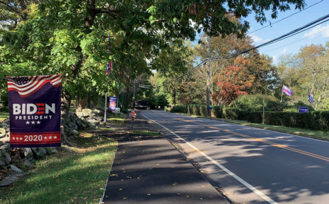 Two competing houses on Maple St. express opposing political viewpoints of the upcoming presidential election through banners, signs and flags. The WPD's press release stated that signs placed on private property may not extend beyond the property line. In addition, it is recommended that residents remove their respective signs within two days after the election, or other specified event.