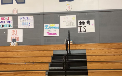 Posters are hung up in the volleyball gym for the seniors before their senior night home game.
