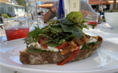 Manna Toast's menu features sourdough toasts topped with a variety of different ingredients. The cafe also serves soups, salads, baked goods and more.