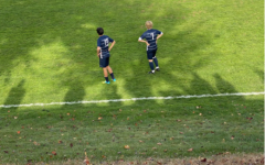 Alan Fiore (right) looks on to Loeffler Field prior to a contest against Ridgefield, in which he scored two of his four goals so far on the year.