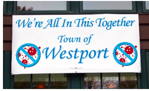 This banner on the door of the Westport Senior Center aims to brighten people's day as they attend one of the Senior Center's COVID programs, free drive by grocery pick up.