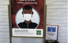 """A sign asks customers at """"The Fresh Market"""" to not enter the store without a mask. Signs like these have been seen frequently in front of stores such as Home Goods and Terrain throughout the pandemic."""