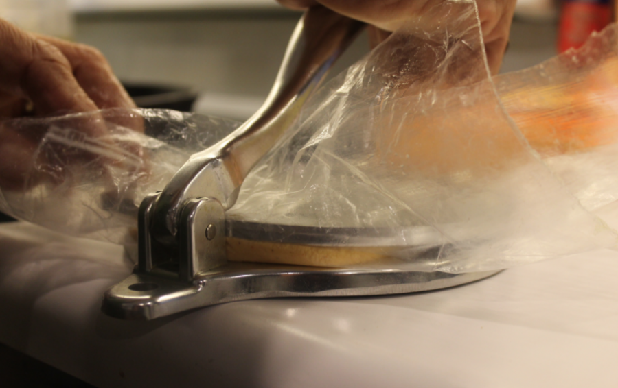 Putting saran wrap on the tortilla press makes it easier to mold and handle the dough, and makes for an easier cleanup afterwards.
