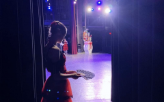Madeline Michalowski '22, one of the Spanish dancers, waits backstage at the Westport Academy of Dance's 2019 performance of The Nutcracker.
