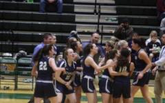 The Staples girls' basketball team celebrating after upsetting Norwalk on the road.