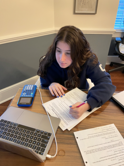 Jess Mysel '23 has been struggling to focus while doing online school. Mysel is in the midst of moving houses with her family, therefore the constant activity going on around her is hard to focus with. Mysel, like many other Staples students, is desperate for in-person learning.