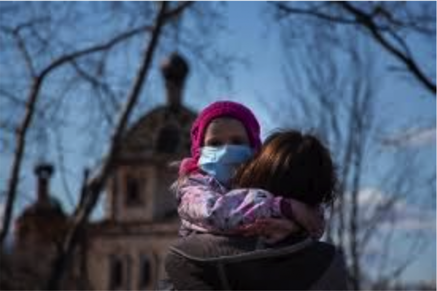 Young girl and her mother head to church with masks to participate in a socially distanced gathering.