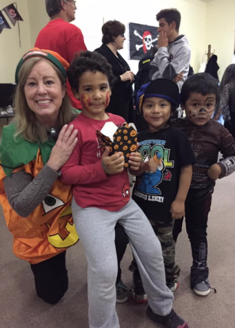 Youth Ministry leader at Saint Luke's Church, Deb Toner, volunteers at a Halloween event at the Caroline House in Bridgeport. She spends a lot of time volunteering there and has been able to bond with dozens of children over her years. This is just one way that she enjoys giving back to the community.