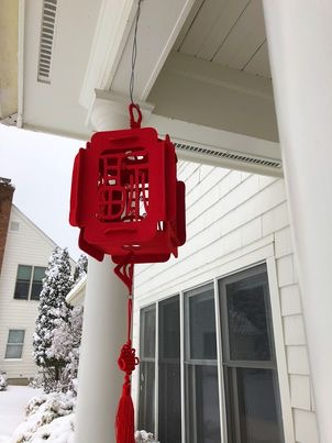Couplets are hung outside houses to protect the household from evil and welcome prosperity.