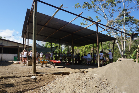 February Trip 2020. Students in one group traveled to Costa Rica where they built a learning center in the town of Boruca. This photo is from the beginning of the process where students are sectioned off in little groups to mix cement and stack building blocks.