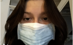 Grace Fuori '23 is shown properly wearing her double masks, and says she is ready to wear them in public if need be.