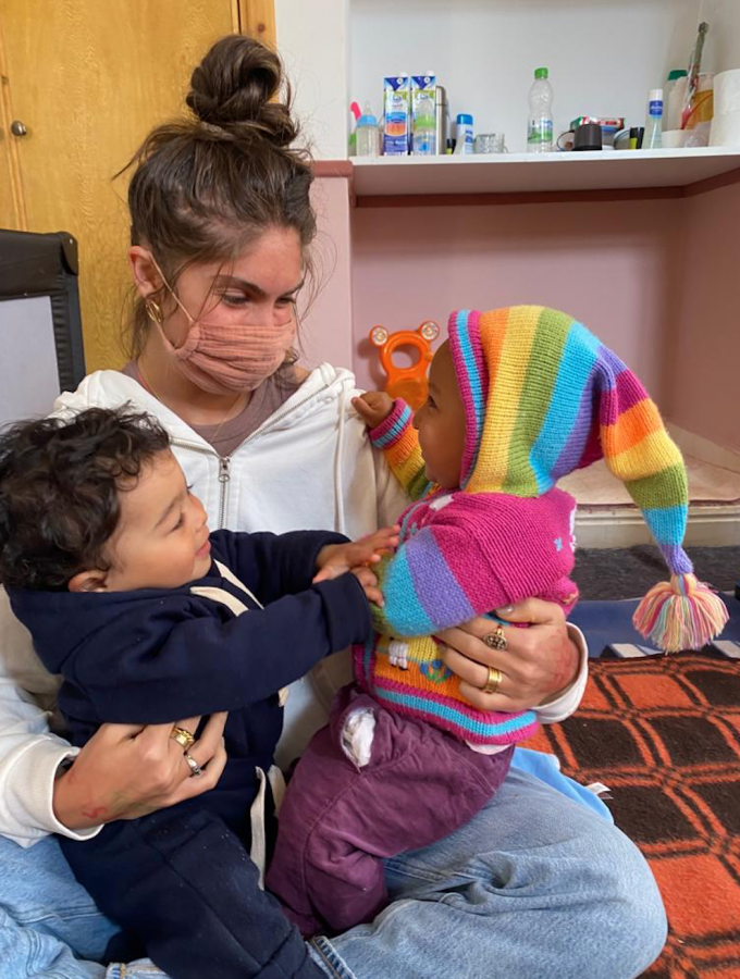 Remi Levitt '21 sits with two children from the orphanage where she volunteers. The American Friends of Atlas Kinder Foundation is an organization founded by her mother, Keri Levitt, and has inspired Remi's return to Marrakech this winter.