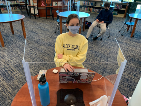 Emma Losonczy '23 uses music as a way of focusing while studying in the library. The music helps Losonczy  keep her mind awake while she writes an essay for English class.