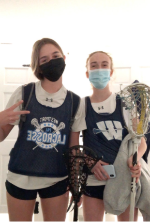 Shannon Lynch '23 and Caroline Cooper '24 prepare for the second week of girls' lacrosse pre-season.