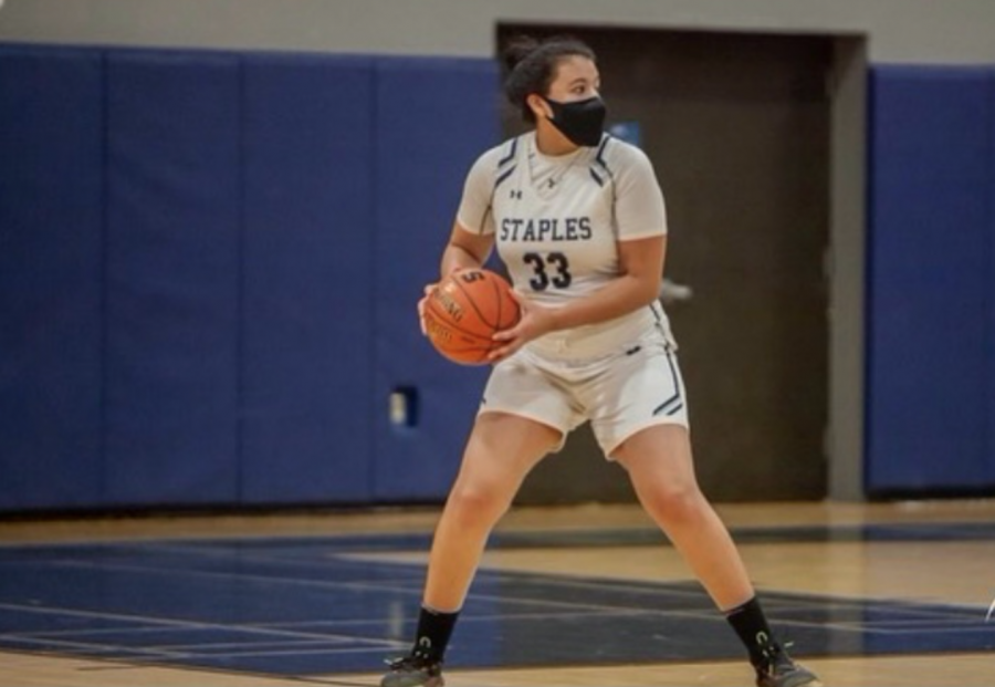 Marley Lopez '21 is actively playing in her basketball game back in 2020. Her high school career was one of the best experiences for her, but this year, contact tracing suddenly prohibiting her participation in the last basketball game of her career.