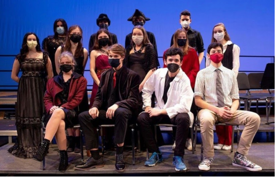 Players' Dracula cast don red and black costumes for the show as well as coordinating masks.