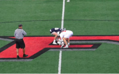 Henry Dodge '22 lines up for the opening face off vs. Fairfield Prep.