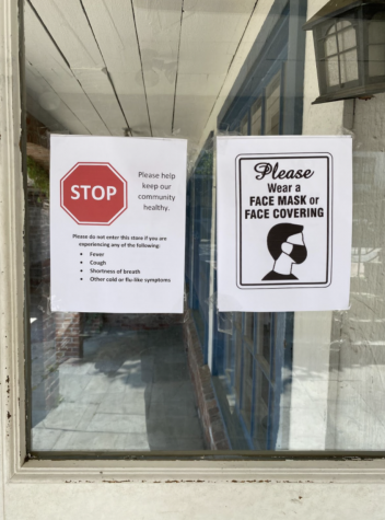 Signs posted in the windows of Brandy Melville in downtown Westport show customers that masks are still required despite the recent CDC guidelines.