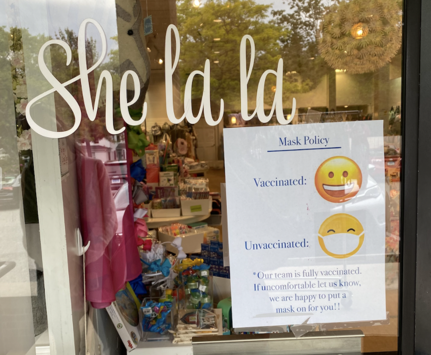 She La La, a retail business, along with other buildings in Westport, have put signs in their storefront to inform customers of their mask policy.