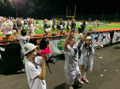 Superfan Captains lead the school spirit at all school sporting events. Here they rally the fan section at the last Staples football game on Sept. 17 vs St. Joseph. The Wreckers lost 35-14.