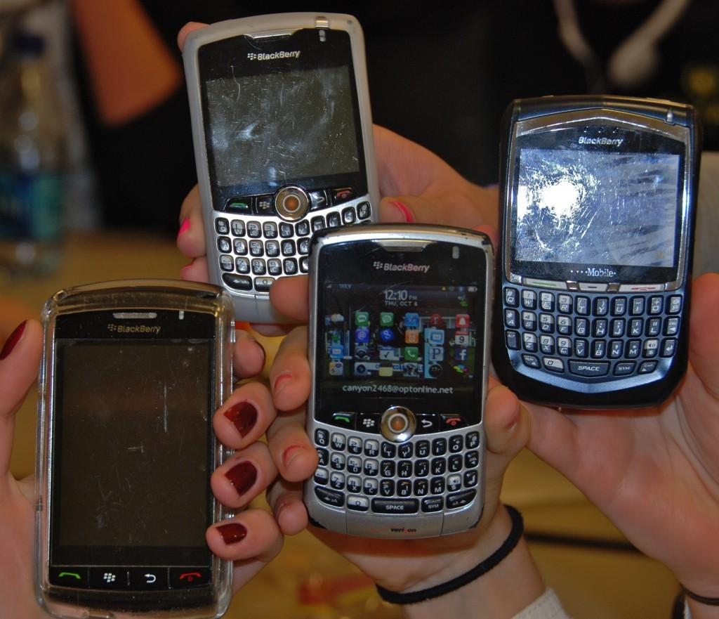 Berry Nice: Always with their Blackberrys in hand, these students show off the various models of the phone. | Photo by Meghan Prior '11