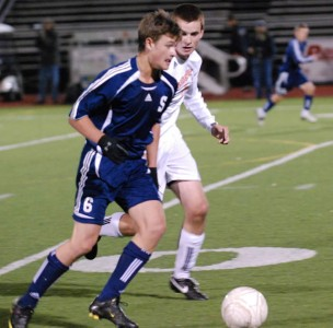 Greg Gudis '11 brings the ball up the field. | Contributed by Lisa Krosse