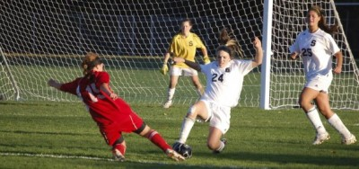 Kelly Bohling '11 works hard to defend her goal.| Photo by Eric Essagof '12