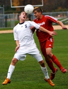 Brendan Lesch battles a Conard Chieftan for the ball in Staples' first round state tournament victory. Photo courtesy of Staplessoccer.com (Carl McNair)
