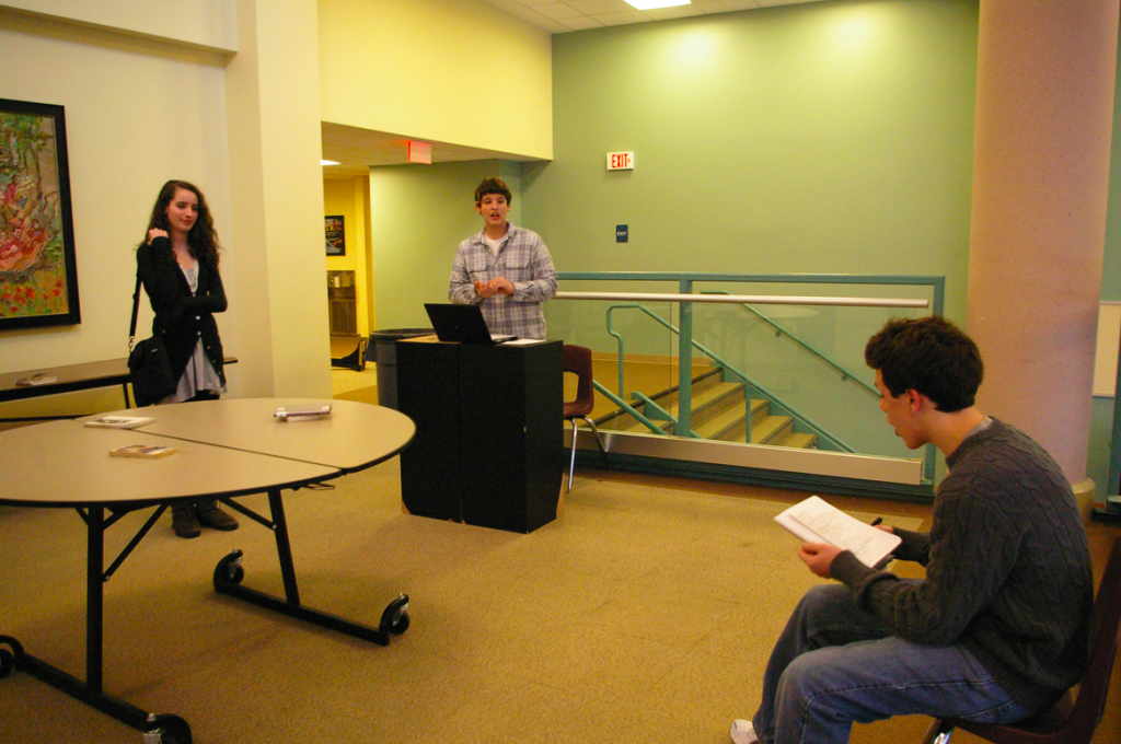 Director Adam Bangser '10 instructs his actors, Charlotte SMith '12 and Clay SInger '13, in his one act,
