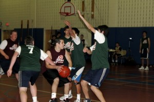 James Betar '10 is triple-teamed by opposing players | Photo by Natasha Gabbay '10
