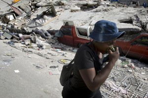 A woman walks bodies pulled out from the rubbles of a building that collapsed after the earthquake that rocked Port au Prince on January 12. Photo Morco Dormino