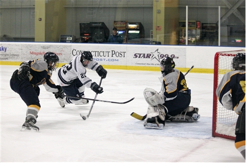 Kyle Wehmhoff '12 takes a shot on goal in a recent game against Housatonic. | Photo courtesy of stapleshockey.com (Anna Andriuk)