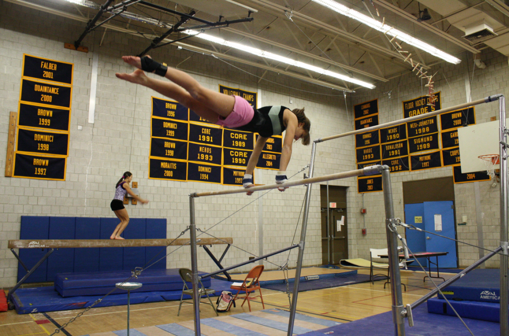 Tri-captain Kara Tricarico 11 practices her routine on the bars. | Photo by Annie Nelson 11