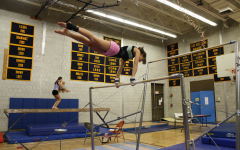 Tri-captain Kara Tricarico '11 practices her routine on the bars. | Photo by Annie Nelson '11